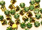 Rhinestones in settings<br>17ss Peridot<br>2 gross for